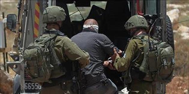 İsrail askerleri 21 Filistinliyi gözaltına aldı