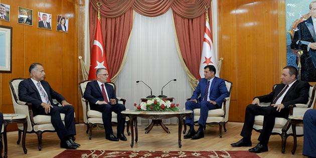 BAŞBAKAN ÖZGÜRGÜN TC MALİYE BAKANI AĞBAL'I KABUL ETTİ