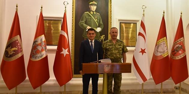 Bakan Oğuz Tümgeneral Öztürk'ü ziyaret etti